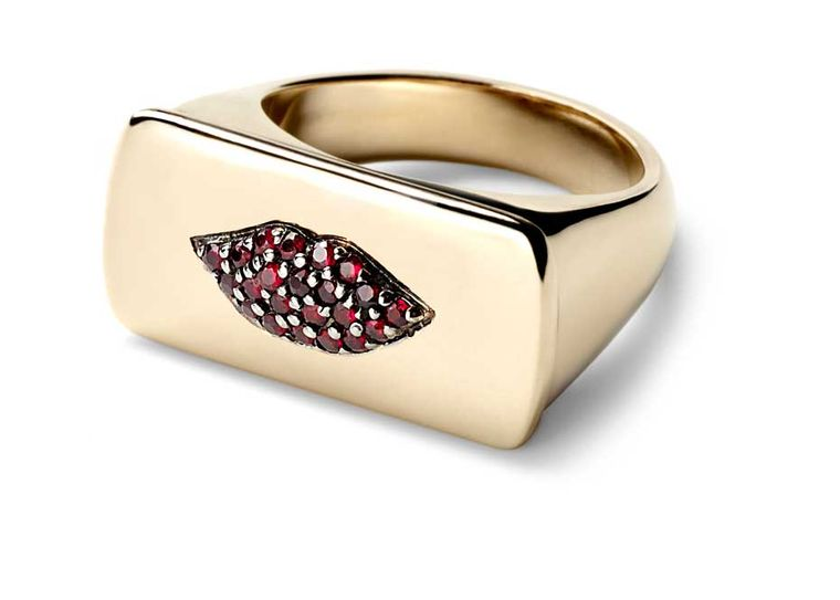 The Alison Lou Ruby Lips ring features puckered lips adorned with pavé rubies.