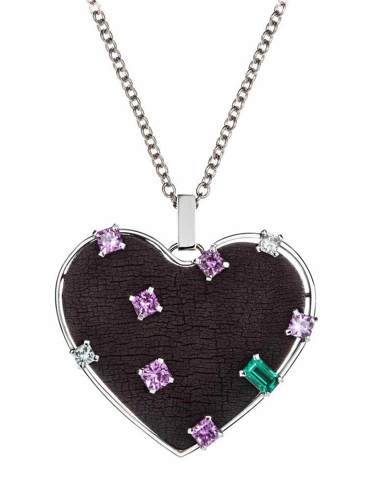 Wilfredo Rosado necklace in white gold with emeralds, pink sapphires and diamonds set into a burnt wood heart pendant.