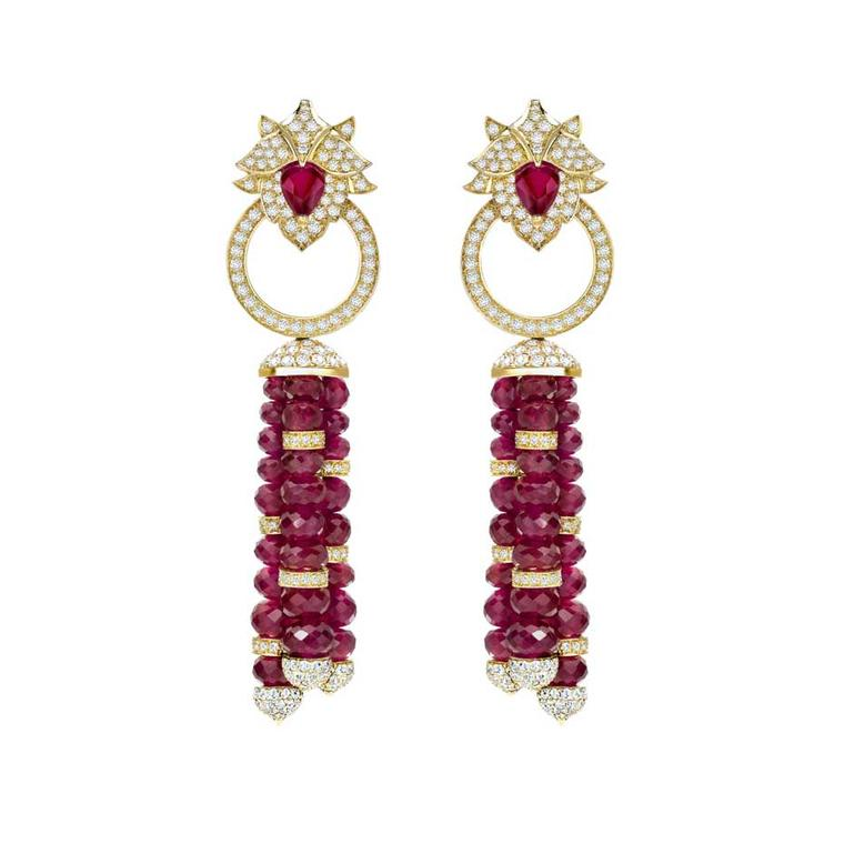 Delicate high jewellery Lotus ruby earrings from Asprey London feature a pavé diamond lotus flower motif in yellow gold at the ear and multi-faceted pear-shaped rubies on the tassels.
