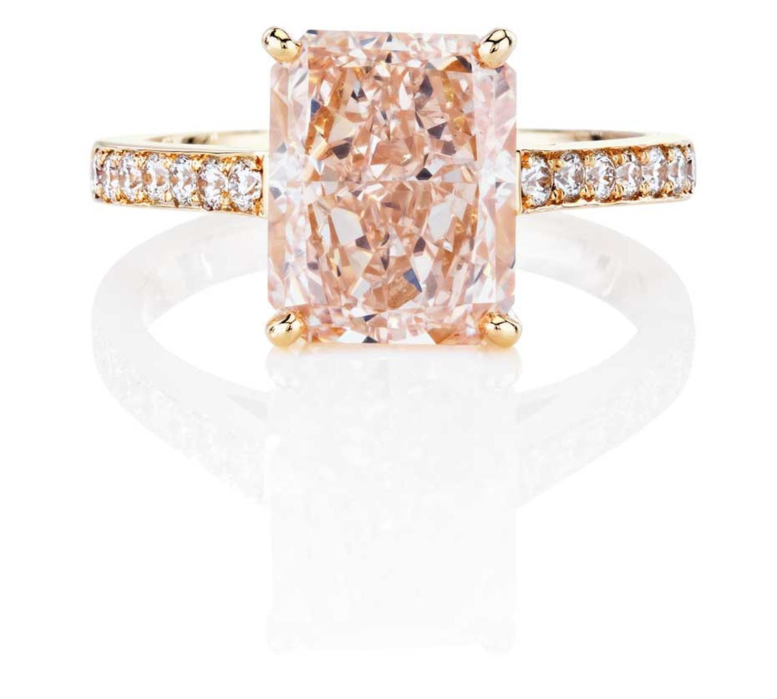 De Beers Classic pink diamond engagement ring, from the 1888 Master Diamonds collection, set with a Fancy pink diamond with pavé white diamonds around the band.