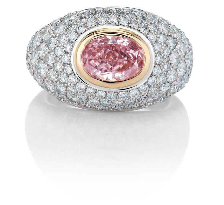 De Beers Aurora pink diamond ring, from the 1888 Master Diamonds and Creative Solitaires collection, set with an oval Fancy Intense pink diamond surrounded by pavé white diamonds.