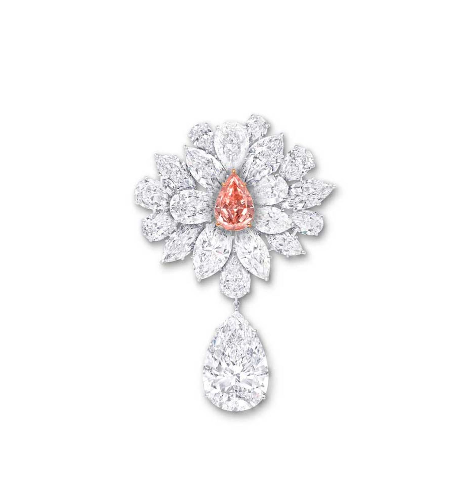 Graff's Diamond Flower Brooch, unveiled at the 2014 Biennale des Antiquaires in Paris, features an 8.97ct pear-shaped Fancy Vivid Pink Orange diamond, surrounded by a spray of white diamond petals and leaves.
