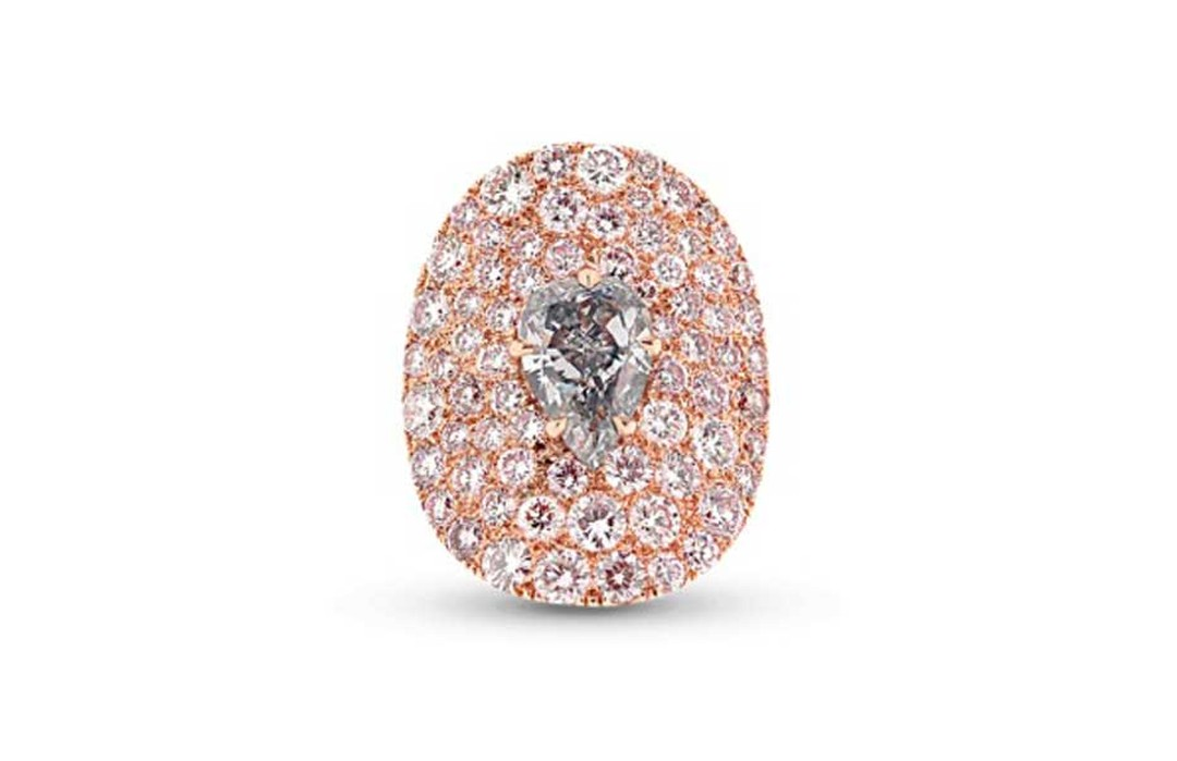 "This Star Diamond ""The Tear of Paris"" ring is set with a rare grey blue diamond set amongst a sea of Fancy pink diamonds."