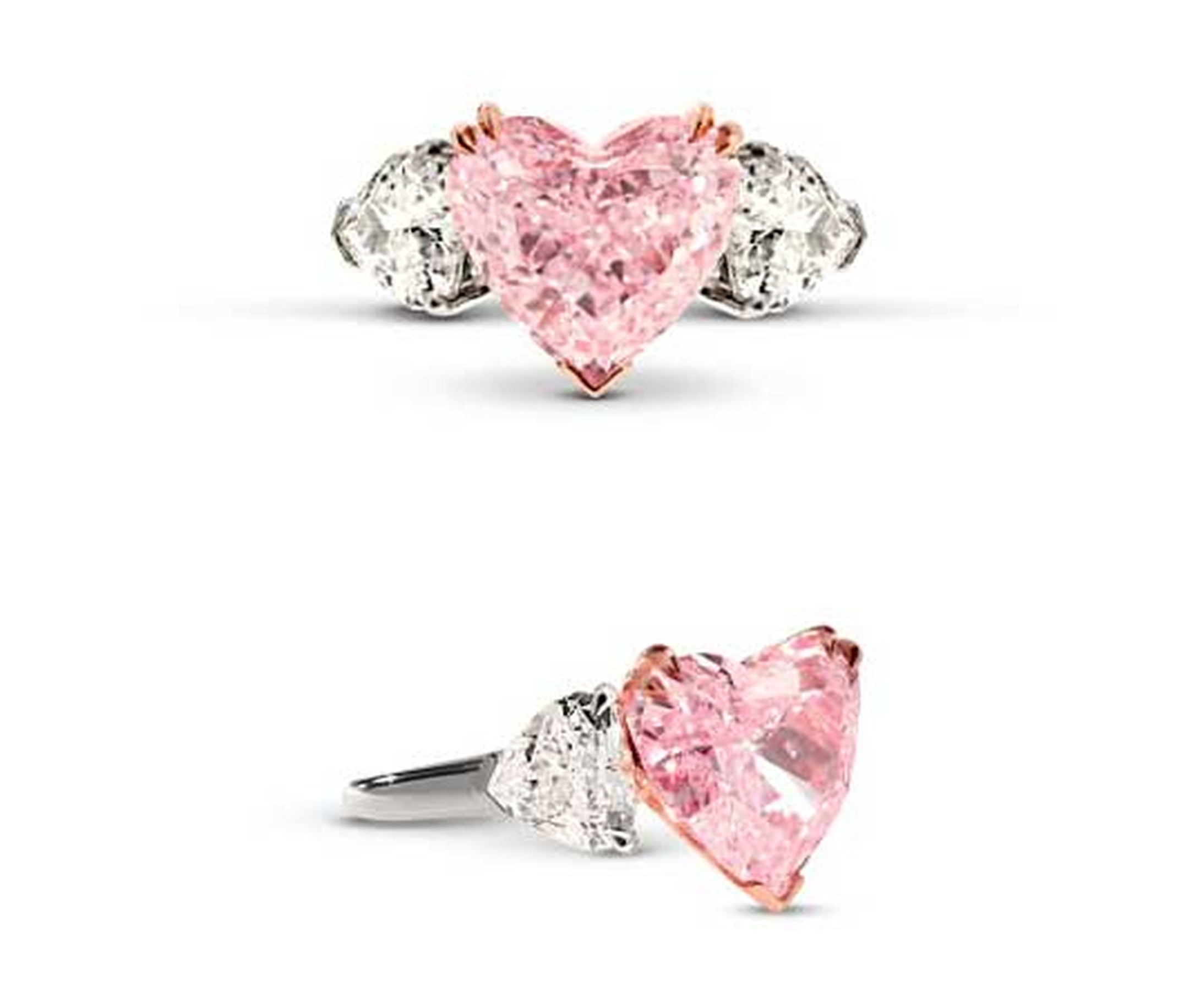 Star Diamond pink diamond engagement ring, set with a 5.32ct heart-shaped Intense pink diamond, flanked on either side by white diamonds.