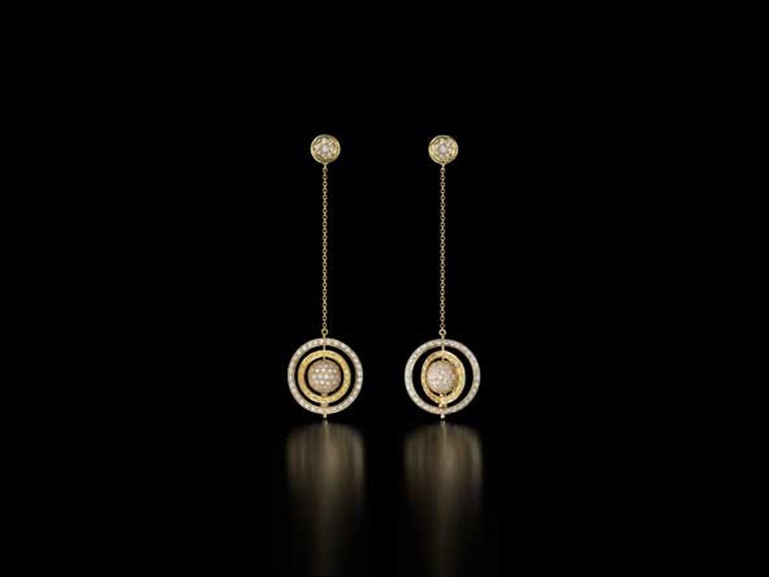 The Spinning Orb earrings in gold with yellow and white pavé diamonds from Liv Ballard.