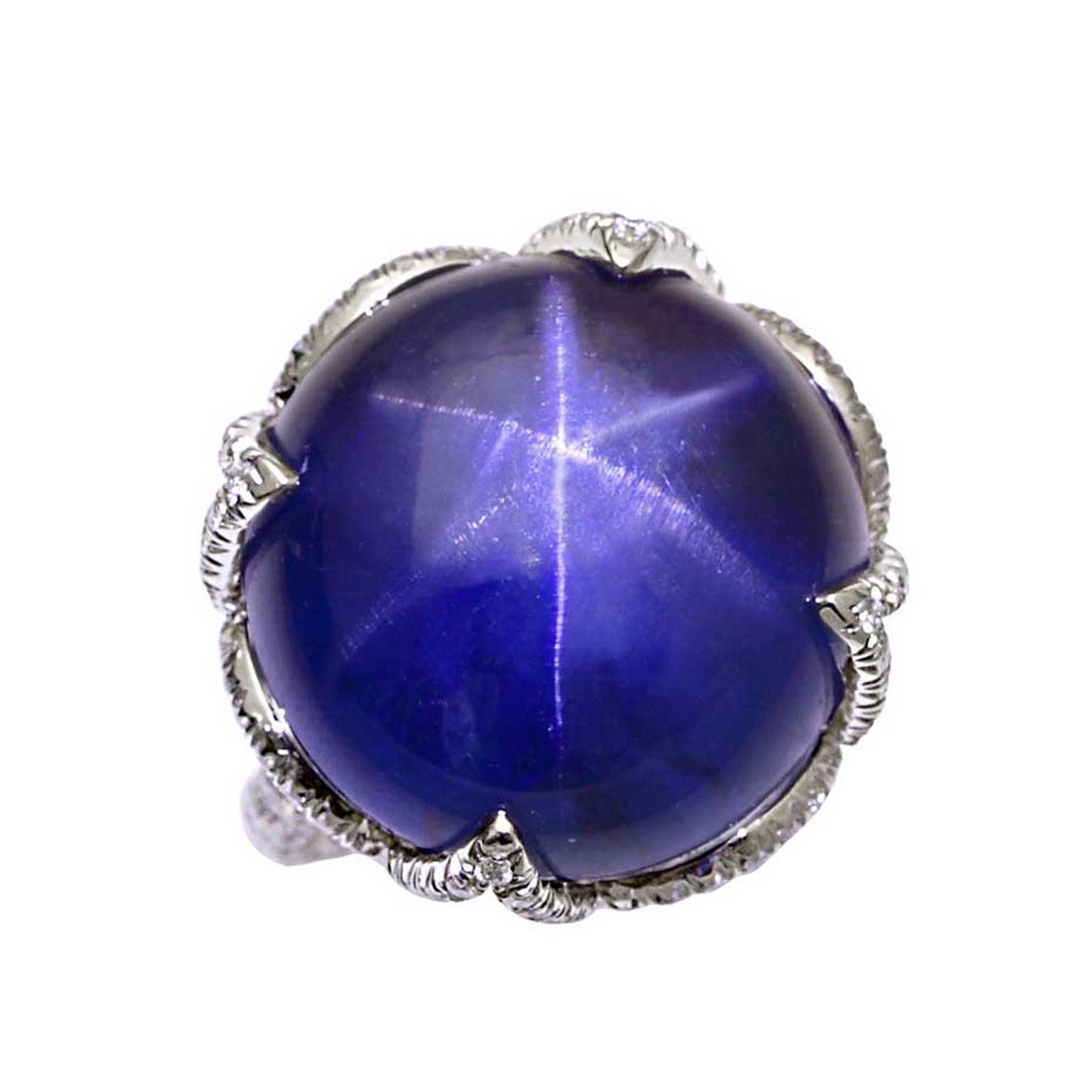 Natural star sapphire lotus ring in platinum with diamonds. Available at 1stdibs.com.