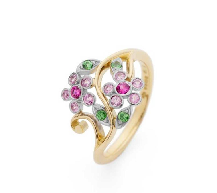 Erica Sharpe Single Flower engagement ring Fairtrade gold with pink sapphires and tsavorite garnets.