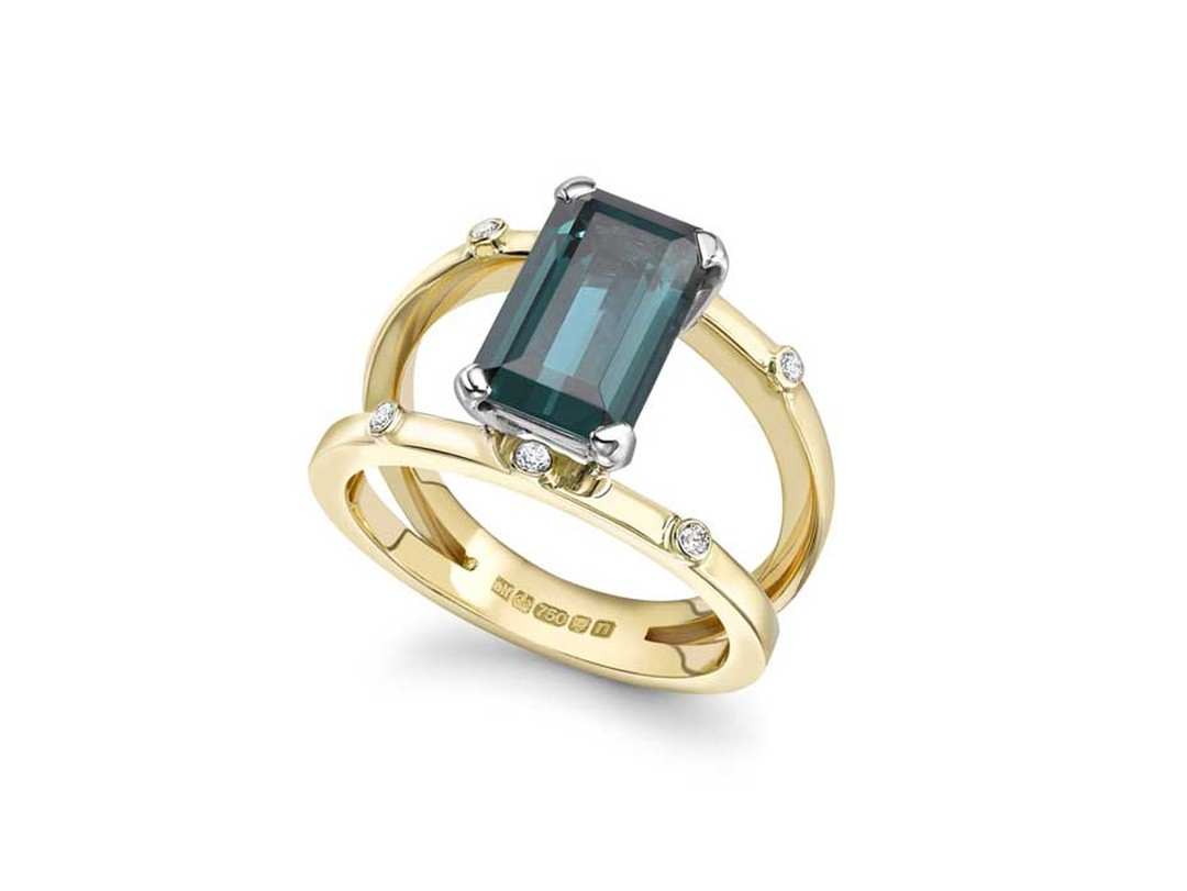 Emma Franklin tourmaline engagement ring in yellow gold, with a suspended emerald-cut tourmaline and six small diamonds.