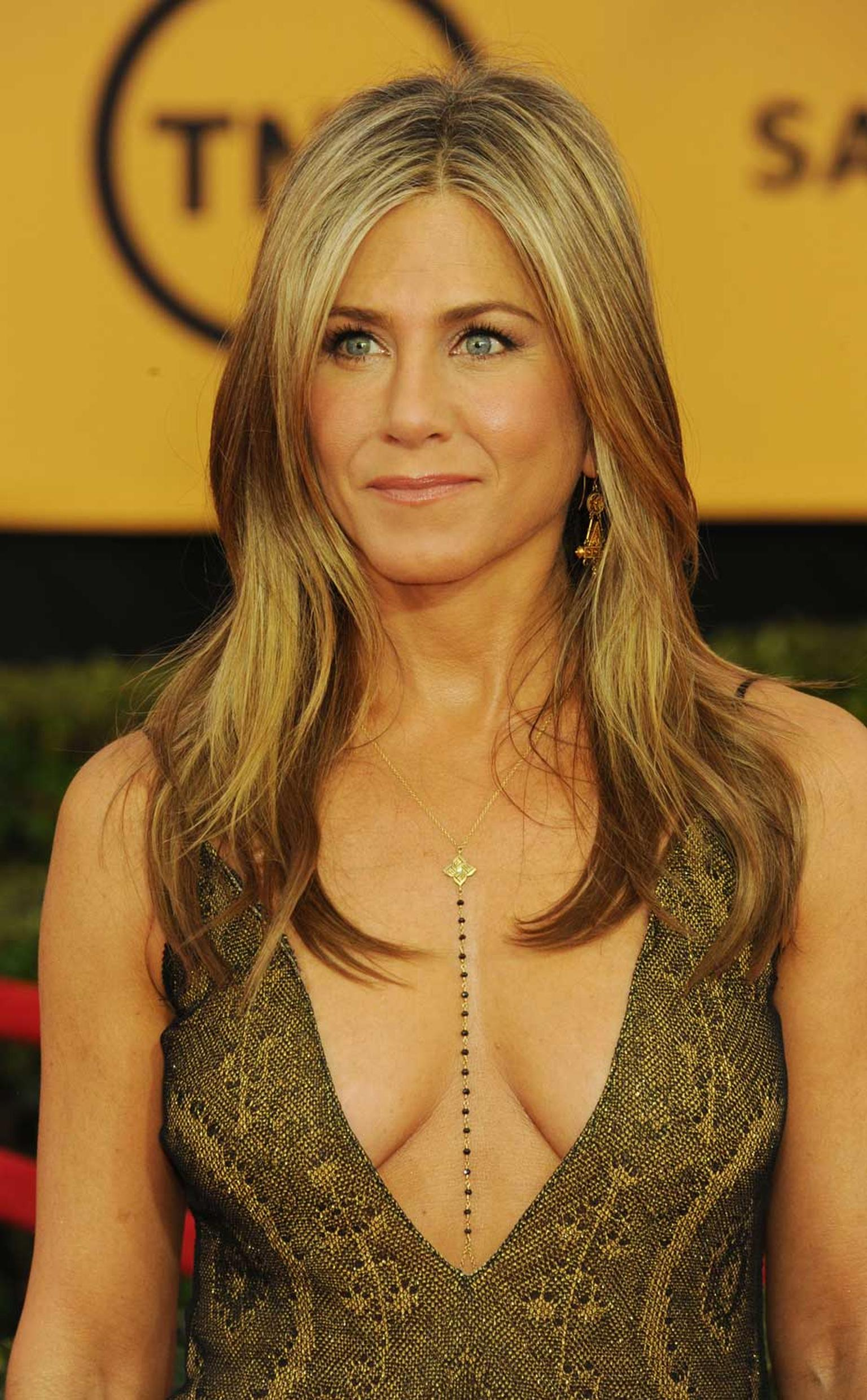 Jennifer Aniston, who was nominated for Outstanding Performance by a Female Actor in a Leading Role, wore gold Fred Leighton bracelets and a black diamond body chain by Amrit Jewelry.