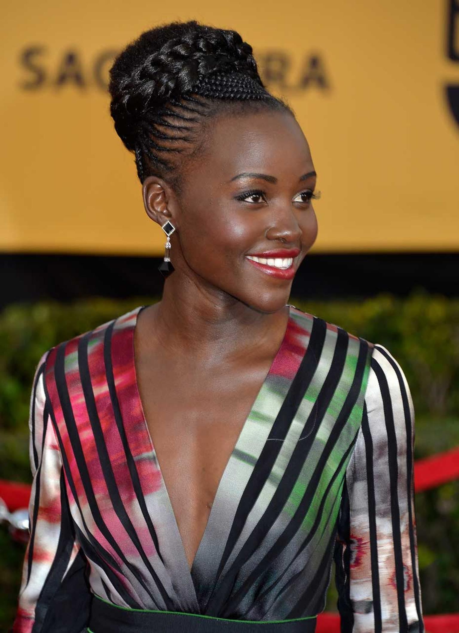 Lupita Nyong'o, pictured at the 2015 SAG Awards in LA, wearing Fred Leighton jewelry, including these stunning Pyramid pendant earrings in black jade, rock crystal and diamond.