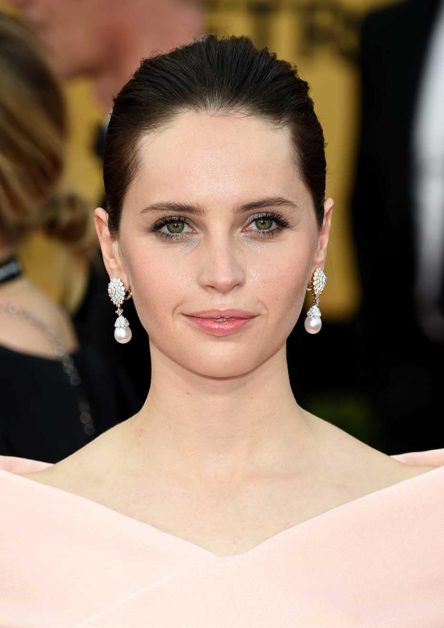 British nominee Felicity Jones sparkled in Van Cleef & Arpels jewelry on the 2015 SAG Awards red carpet. (Ethan Miller/Getty Images)