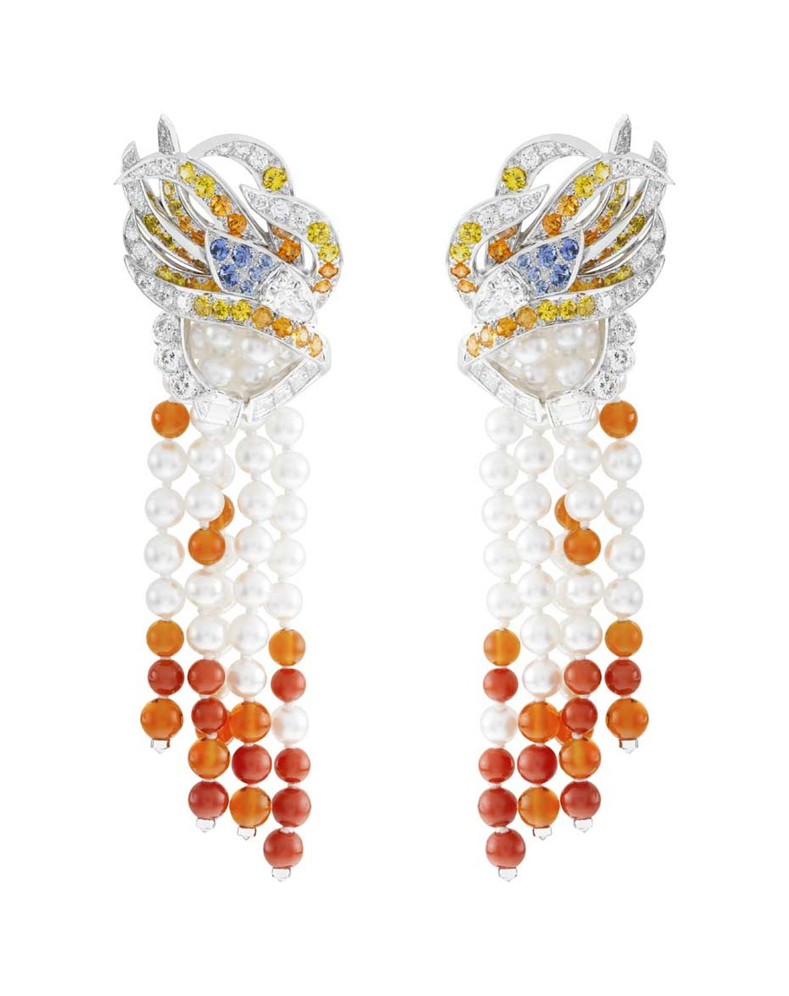 The stunning Oiseau de Feu earrings from the Palais de la Chance collection by Van Cleef & Arpels worn by Viola Davis, featuring diamonds, spessartite garnets, fire opal, red coral, white cultured pearls, blue and yellow sapphires set in white gold.