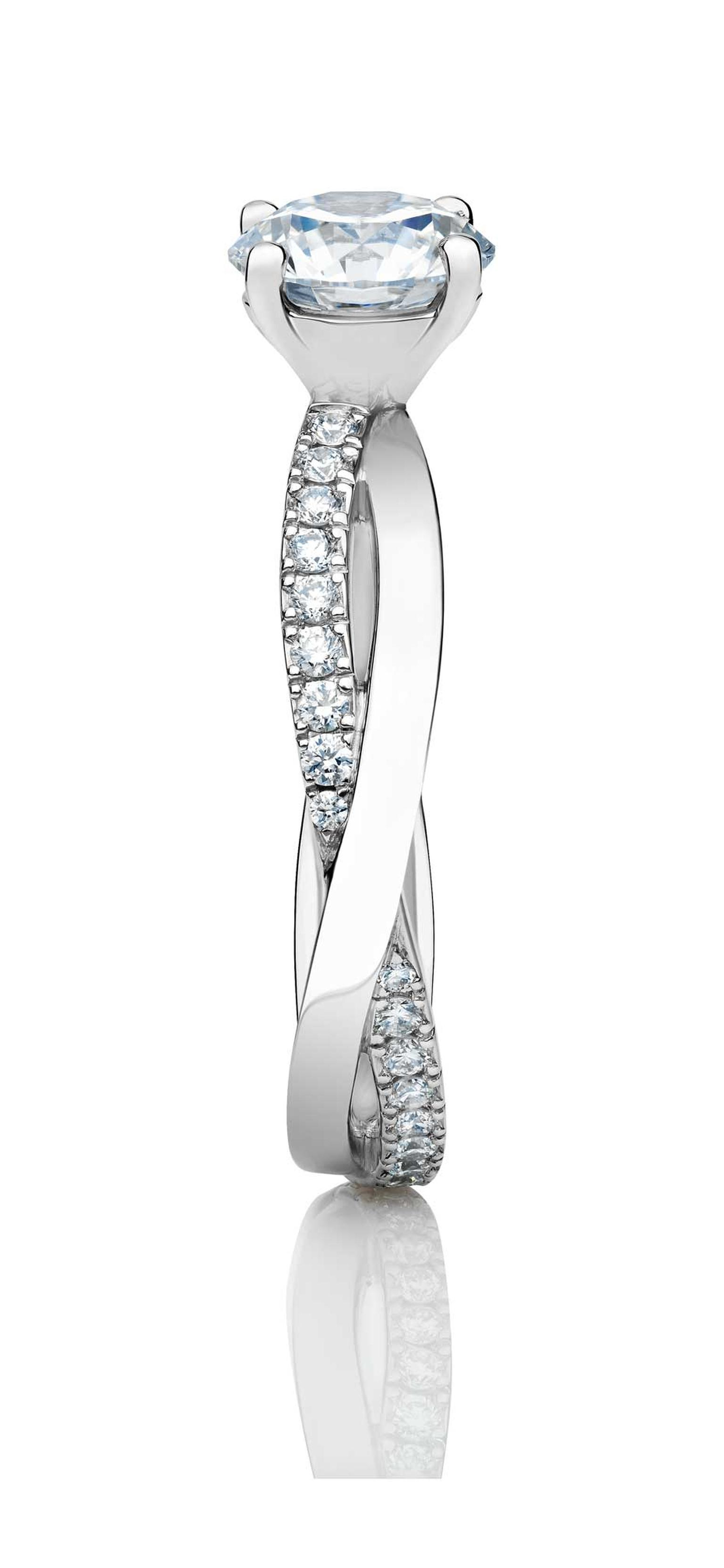 The new De Beers Infinity round diamond engagement ring is topped with a round brilliant-cut solitaire diamond.