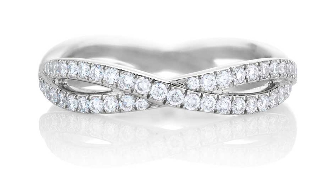 De Beers has designed its new Infinity round diamond engagement ring so it can be neatly stacked with the De Beers Infinity band, pictured.