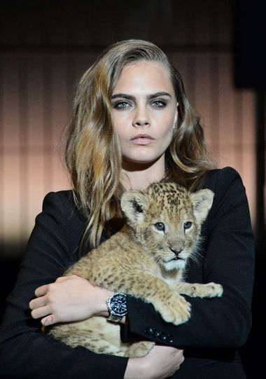 Chick with attitude: Cara Delevingne has been chosen by TAG Heuer watches as its new ambassador and appeared on stage cuddling a lion cub.