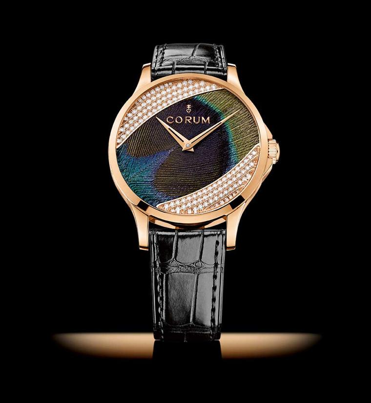 Corum Feather watch presented in a 39mm red gold case with a dial set with peacock fathers framed by 120 round-cut diamonds.