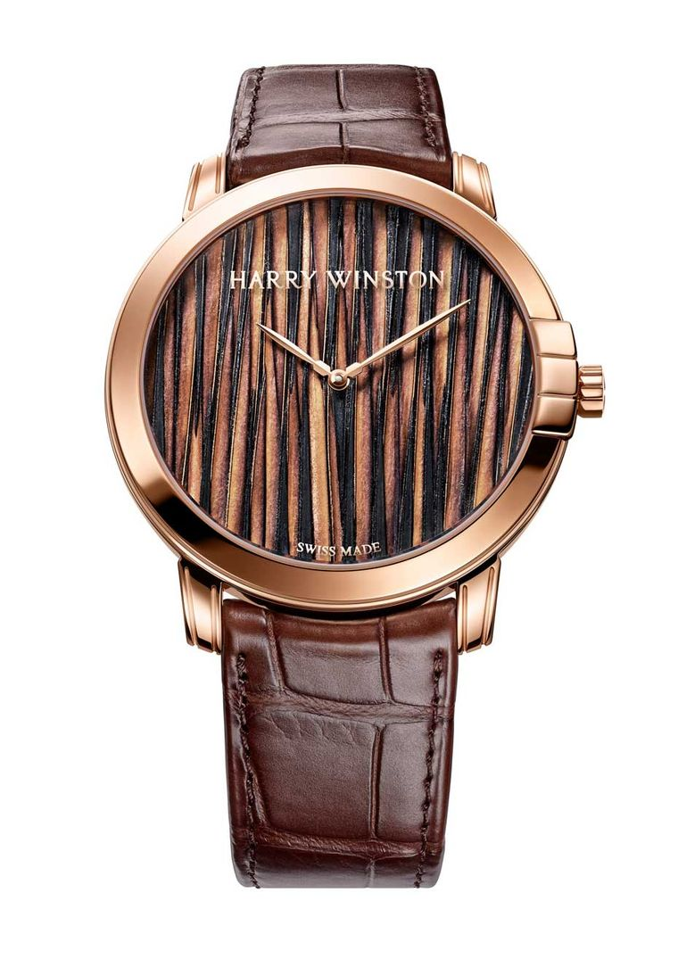 Harry Winston Midnight Feathers Automatic watch simulates a textured fabric on the dial alternating dark and light brown feathers to impart a dynamic rhythm to the dial.
