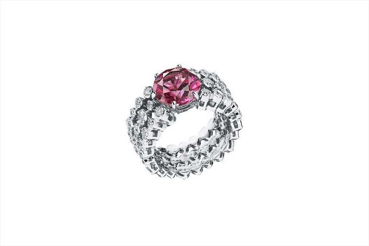 Alexander Arne diamond ring in white gold, set with a central almandine garnet, from the Awakening collection.