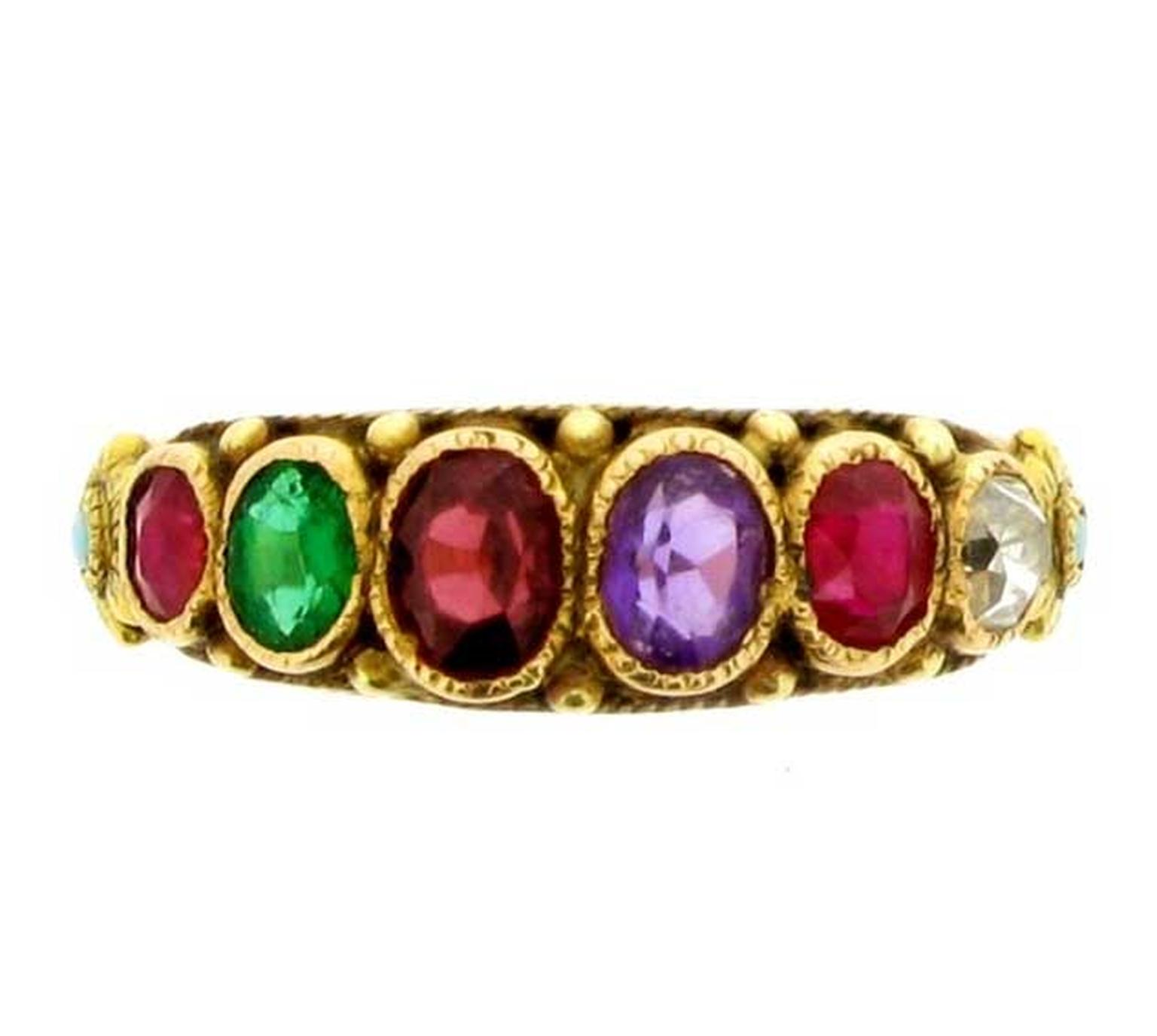 This antique Regard ring in yellow gold is set with a ruby, emerald, garnet, amethyst and diamond. Available from Berganza.