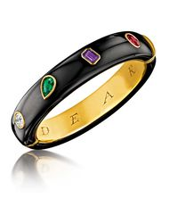 This Victorian-inspired Verdura bangle spells out the word Dear in diamond, emerald, amethyst and ruby.
