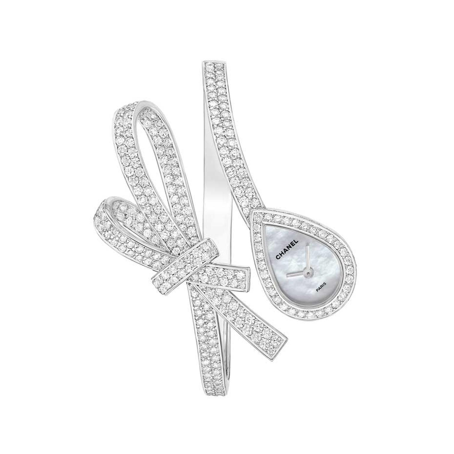 Chanel's diamond watch from the Ruban collection, crafted in white gold and set with 292 brilliant-cut diamonds, features a drop-shaped mother-of-pearl dial attached to one end of a diamond ribbon.