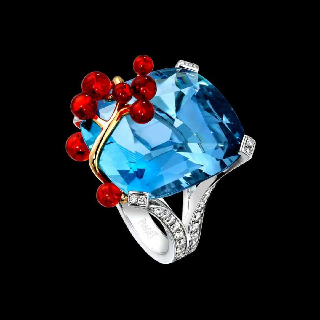 The Limelight Blue Lagoon cocktail inspiration ring from Piaget is set in white gold with a cushion-cut aquamarine, brilliant-cut fire opals and brilliant-cut diamonds.