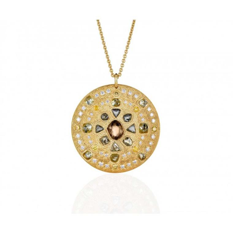 The De Beers Talisman Virtue Strength medallion necklace in yellow gold, set with rough green, brown and yellow diamonds, measures 44m across.