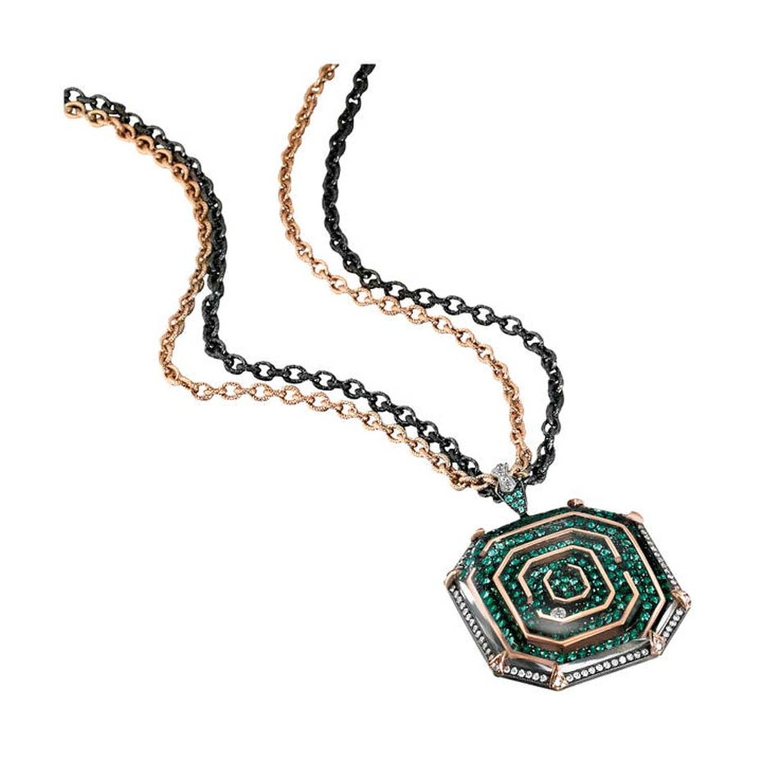 Zaiken for Gemfields necklace in yellow gold and blackened silver, set with Zambian emeralds and a diamond that the wearer can navigate through the maze.