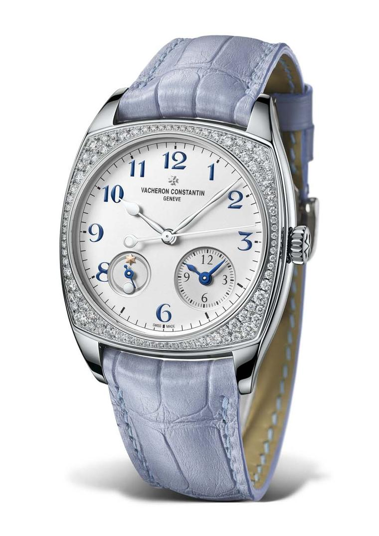 Vacheron Constantin Harmony Dual Time watch for ladies in a 37mm white gold case and bezel set with 88 diamonds. The opaline silver-toned dial ensures clear readings of local and home times, while the gold sun and moon signals indicate day/night functions