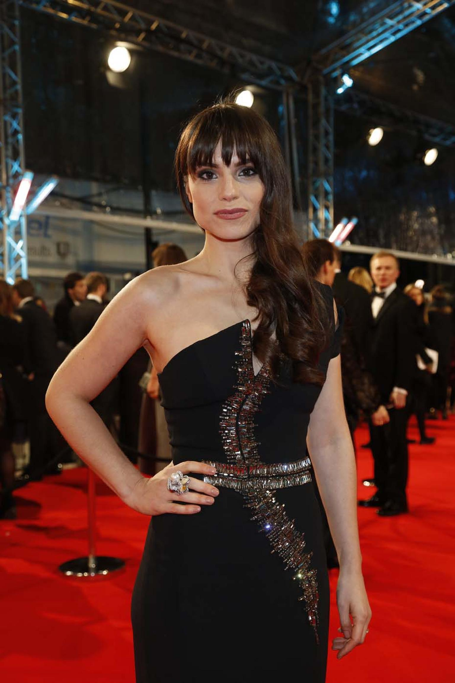 Charlotte Riley wore a YOKO London diamond and opal ring set with Australian South Sea and Tahitian pearls.
