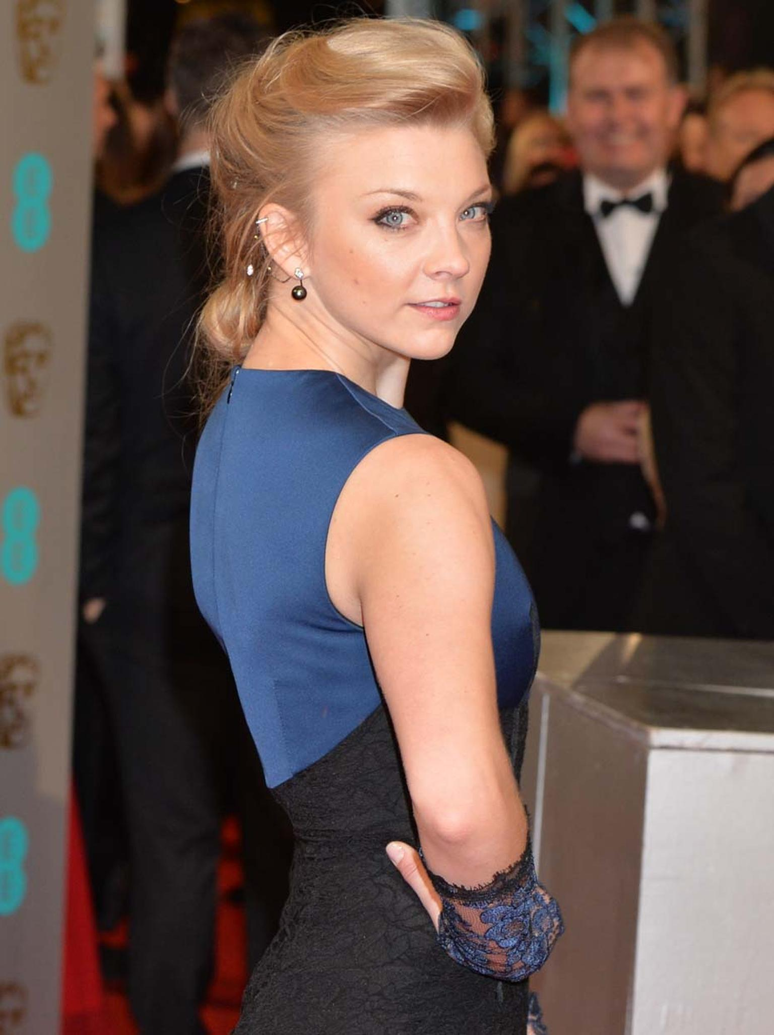 Natalie Dormer wore a YOKO London black gold ear cuff set with diamonds and Tahitian pearls.