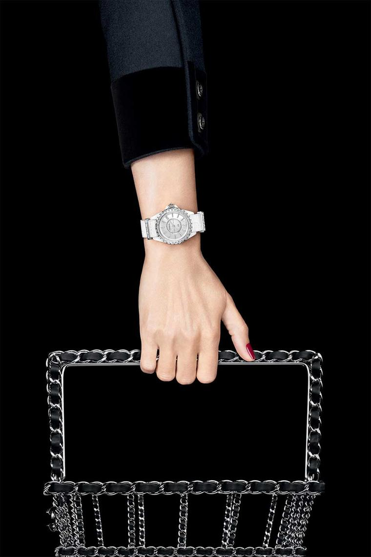 Chanel J12-G10 watch in a 33mm white high-tech ceramic and white gold case with a mother-of-pearl dial and baguette-cut indices. The white gold bezel is set with 34 diamonds and a brilliant-cut diamond is set in the crown. The strap keepers and gold pin b