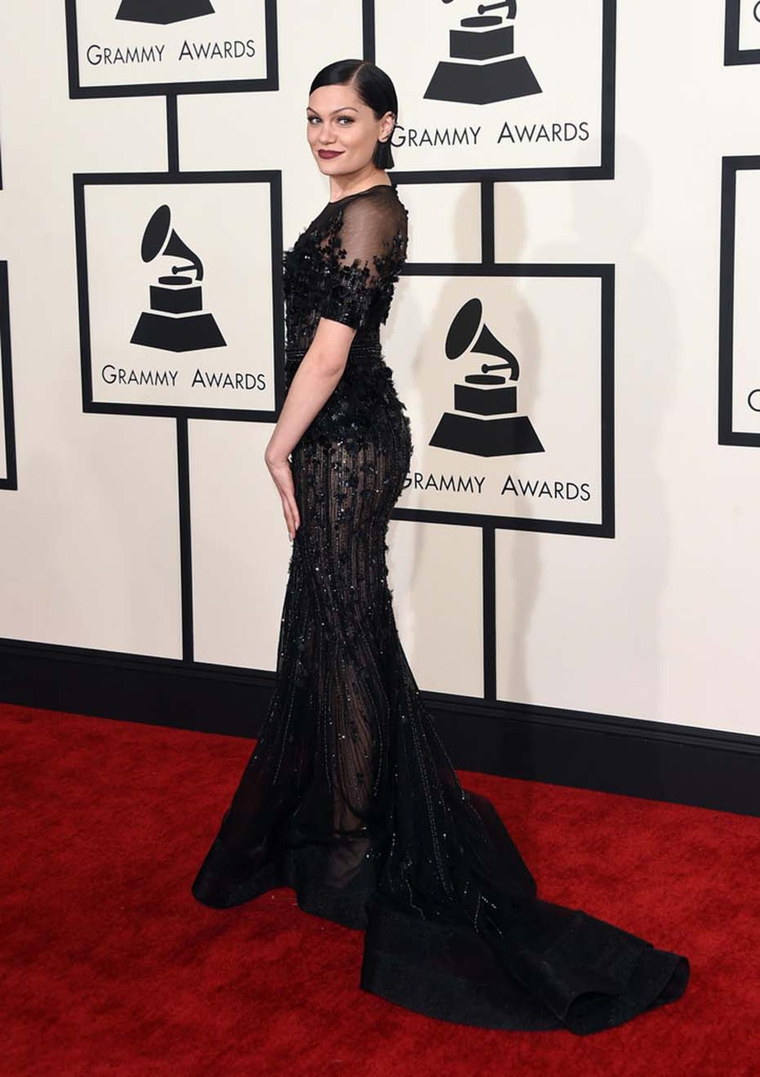 British singer Jessie J was on trend with her red carpet jewelry, accessorising her elegant black gown with a Sutra diamond and black gold ear cuff at the 57th Annual Grammy Awards in Los Angeles, California.
