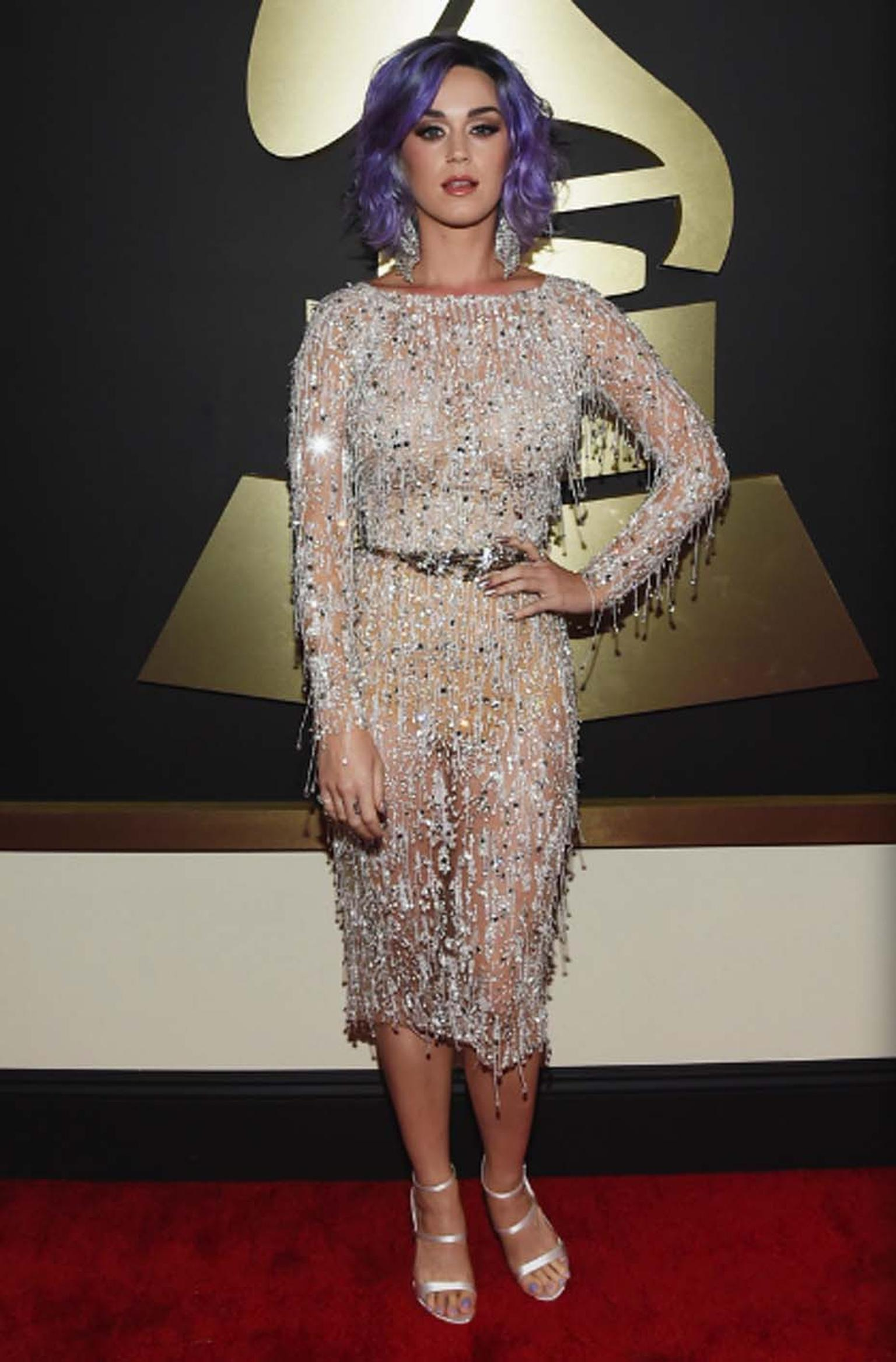 Singer Katy Perry added further sparkle to her red carpet jewelry with a Harry Kotlar canary-yellow diamond ring worth $2 million and a pair of oversized mesh diamond tassel earrings from Lorraine Schwartz at this year's Grammy awards.