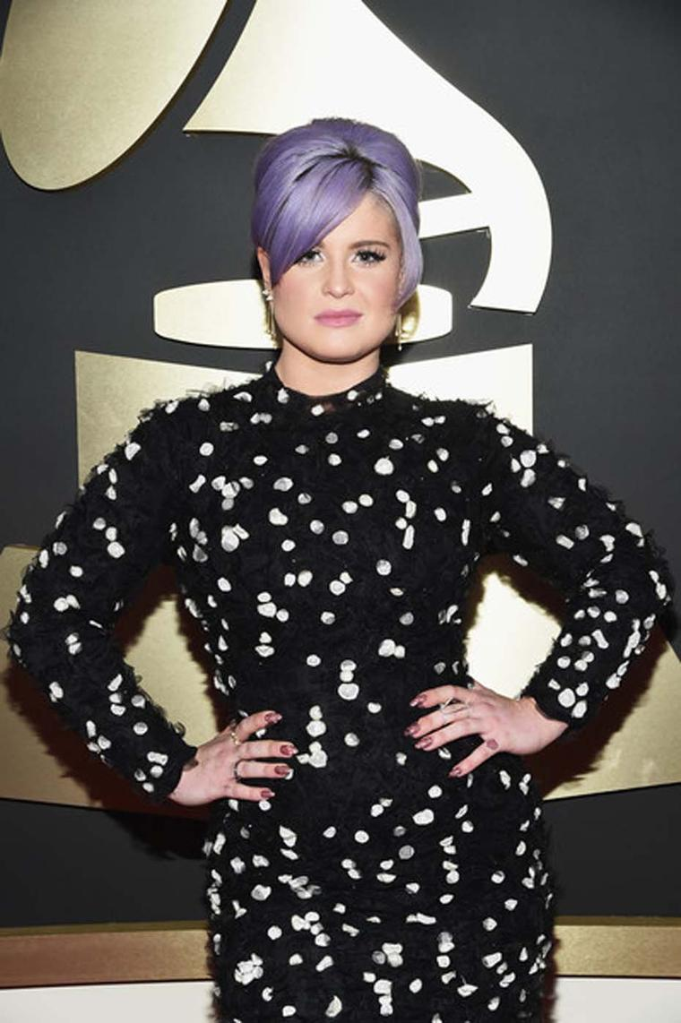 Kelly Osbourne opted for Borgioni diamond earrings and Borgioni diamond rings on the red carpet at the 57th Annual Grammy Awards in Los Angeles.