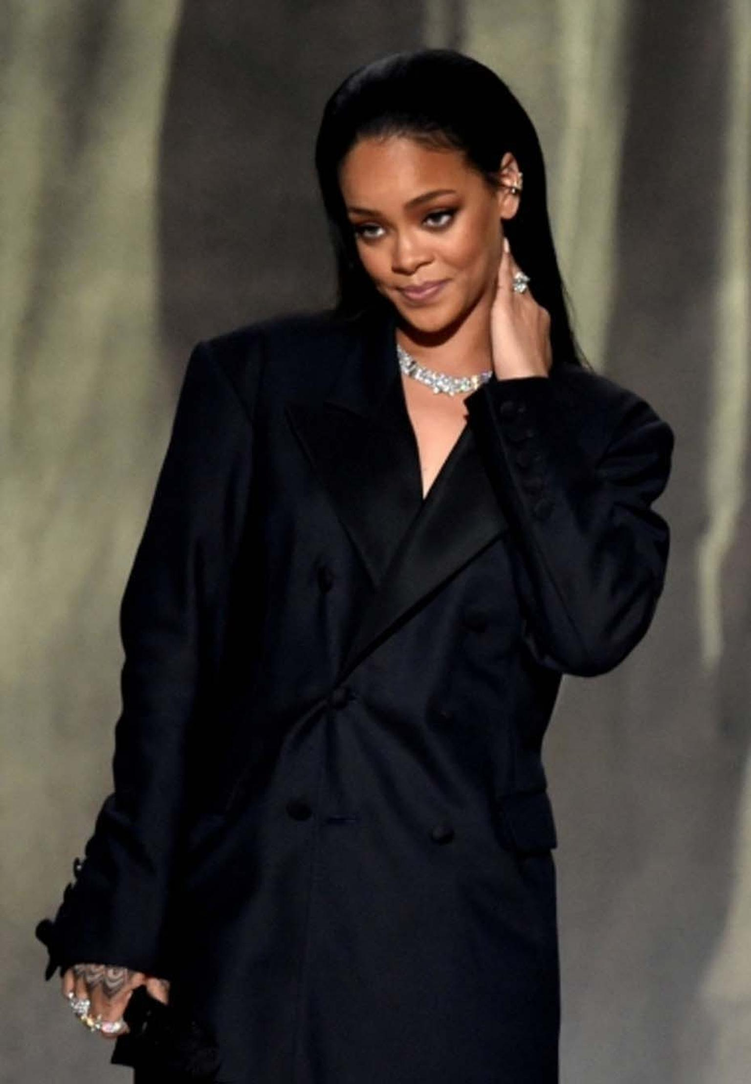 Rihanna teamed her oversized tuxedo jacket with some impressive high jewelry, including a Harry Kotlar 8.00ct pear-shaped diamond ring worth $1 million, a selection of Chopard rings and a stunning Chopard diamond necklace set in platinum, as she took to t