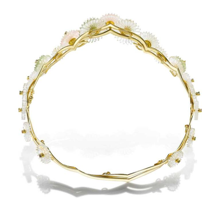 This tiara from the new Alice Ciccolini Summer Snow collection features carved disks made to resemble a cascade of delicate flowers set on gold, crafted to look like bamboo branches.