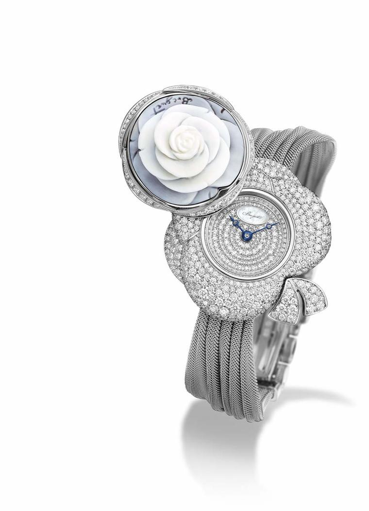 Breguet Rose de la Reine secret watch. By pressing on the dainty cameo rose, the cover pivots, revealing the scintillating dial of the watch, along with the spectacular diamond-set floral case and the ribbon that characterises the Rose de la Reine collect