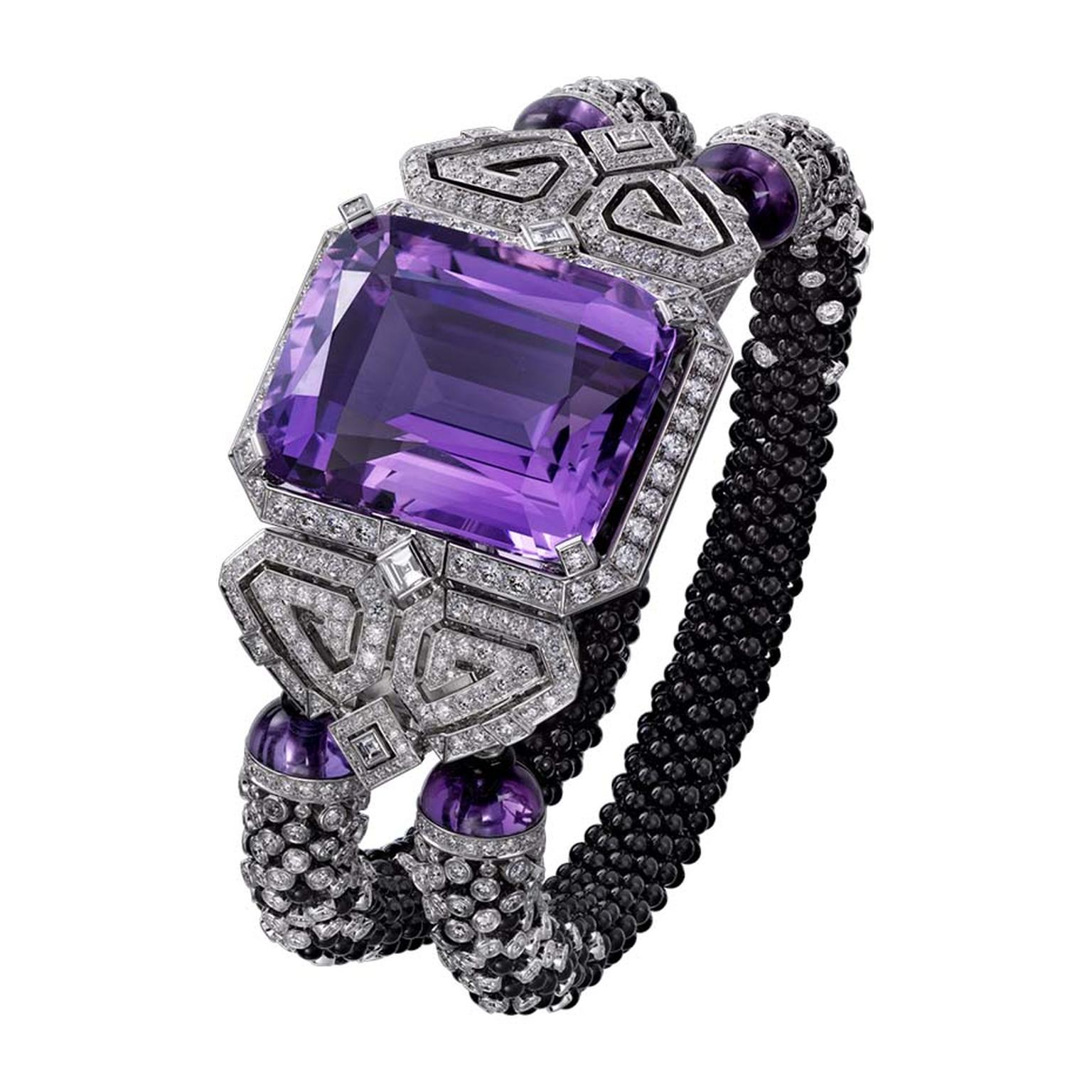 Cartier Purple high jewellery secret watch has two curved scrolls set with onyx and diamonds, which sustain the two diamond and onyx beaded bracelets.