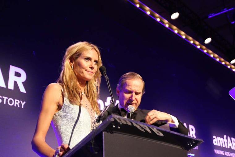 During the annual amfAR event in New York, sponsor Harry Winston auctioned off a pair of Sunflower Cascading diamond earrings, modelled by Heidi Klum.