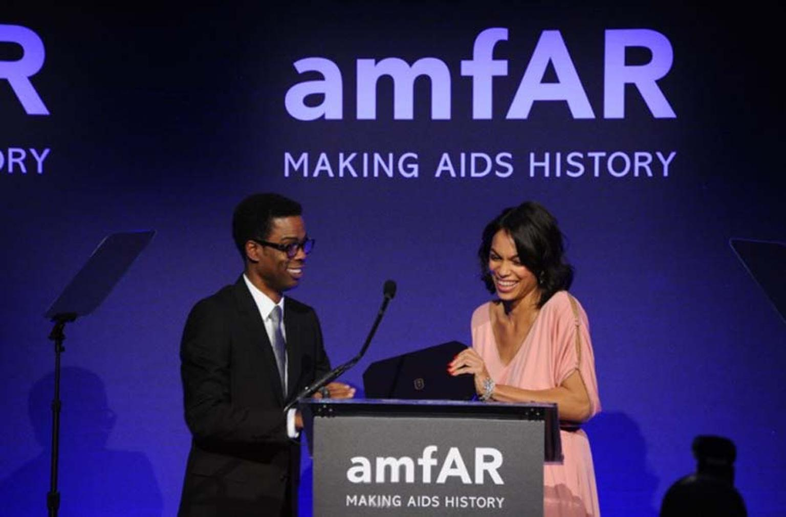 AmfAR honouree and actress Rosario Dawson, who was wearing a selection of sponsor Harry Winston's high jewellery diamond pieces, was presented with a Harry Winston Midnight Timepiece for her outstanding contribution to raising awareness for HIV/AIDS.