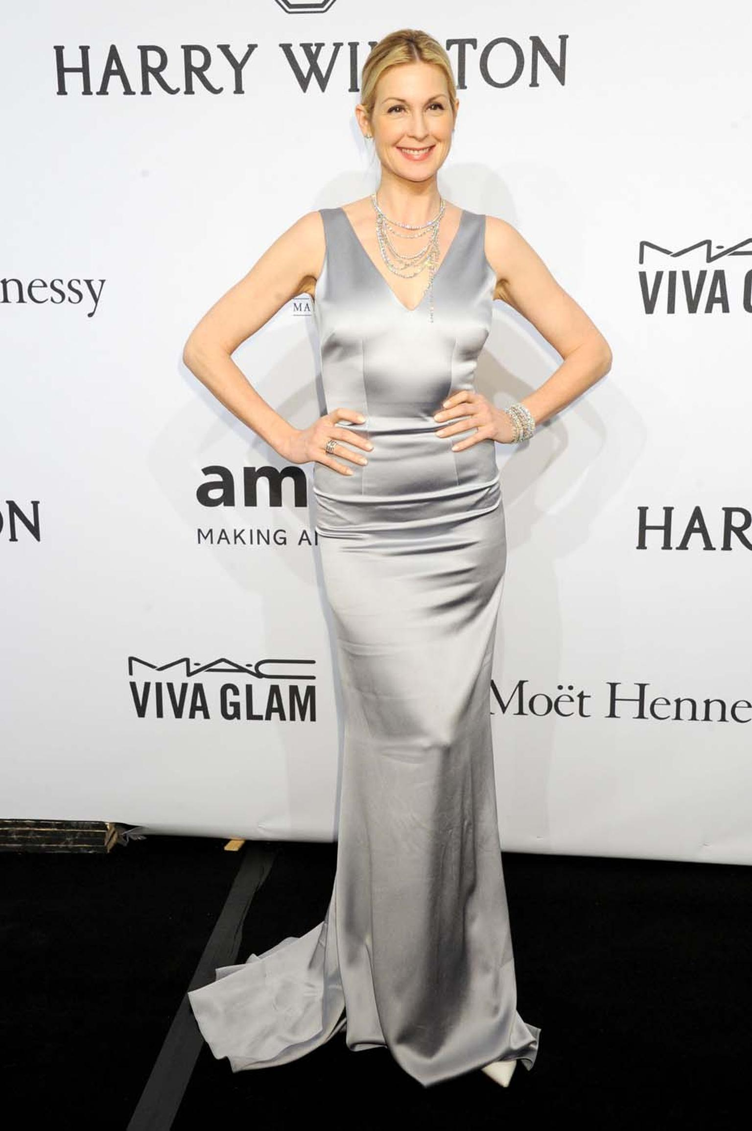 Actress Kelly Rutherford accessorised her stunning silver dress with several pieces from the new high jewellery Secret Combination collection by Harry Winston, at amfAR's New York Gala. Rutherford wore two pieces from the Secret Combination collection, a