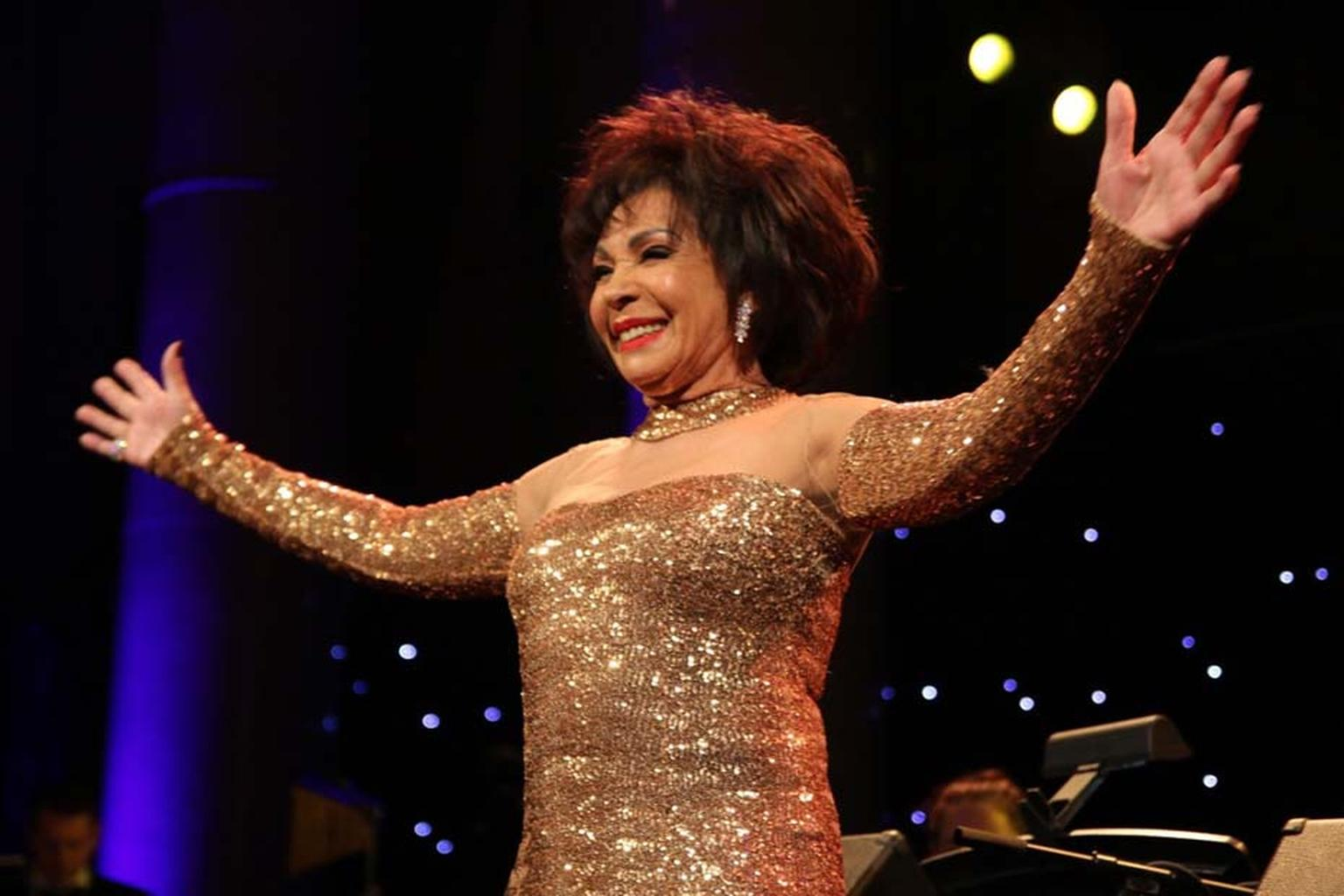 "Dame Shirley Bassey wowed the audience at the amfAR Gala, sponsored by Harry Winston, with a stunning rendition of ""Diamonds are Forever"". The perfect accompaniment to her choice of accessories, which included a Harry Winston 12 carat diamond Carpet Ring"
