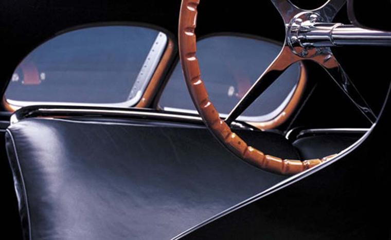 Interior of Ralph Lauren's black Bugatti Type 57SC Atlantic Coupe, a major source of inspiration for the Automotive Collection, incorporating details such as the wood dashboard and the six screws used on the hub to hold the Bugatti steering wheel to the c