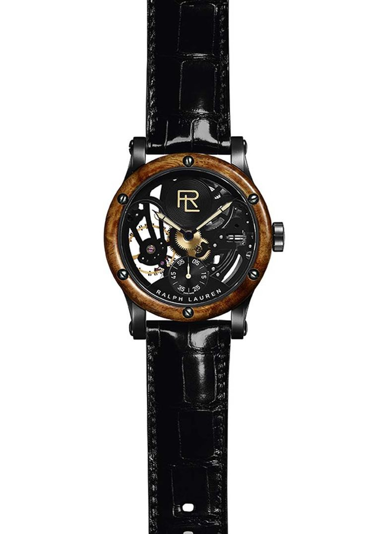Ralph Lauren Automotive Skeleton watch lifts the hood to allow a view of its open-worked skeletonized mechanical engine. It is the first open-worked movement at RL and the bezel has been crafted from amboyna burl, a wood appreciated for its swirling grain