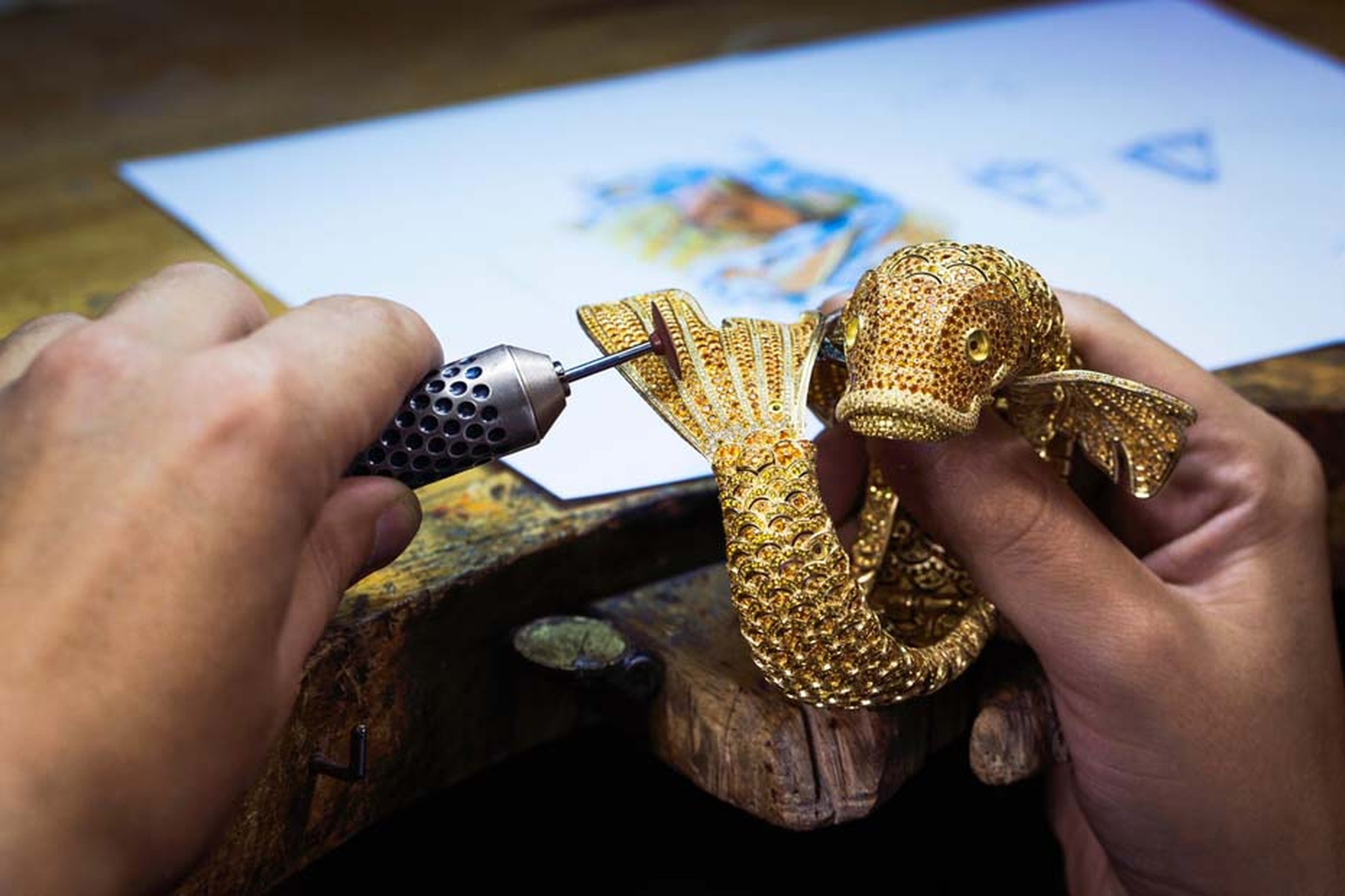 A jeweller polishing the Carpe Koï's tail at the Van Cleef & Arpels ateliers situated on Place Vendôme, Paris.