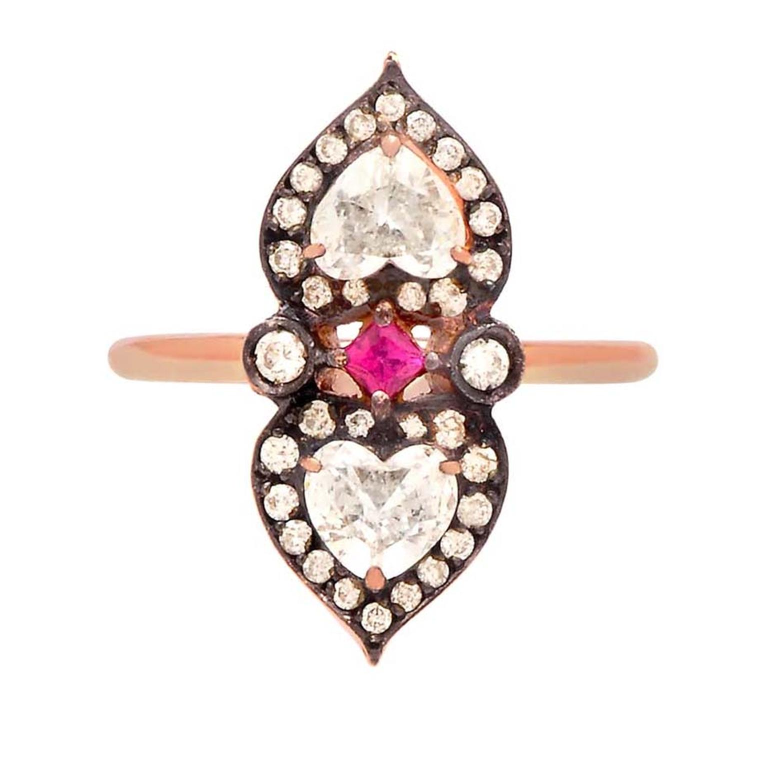 Sabine G's unusual heart-shaped diamond, ruby and rose gold ring from the Relic collection. This handmade engagement ring features two heart-shaped white diamonds set in heart-shaped, diamond-set, rose gold.