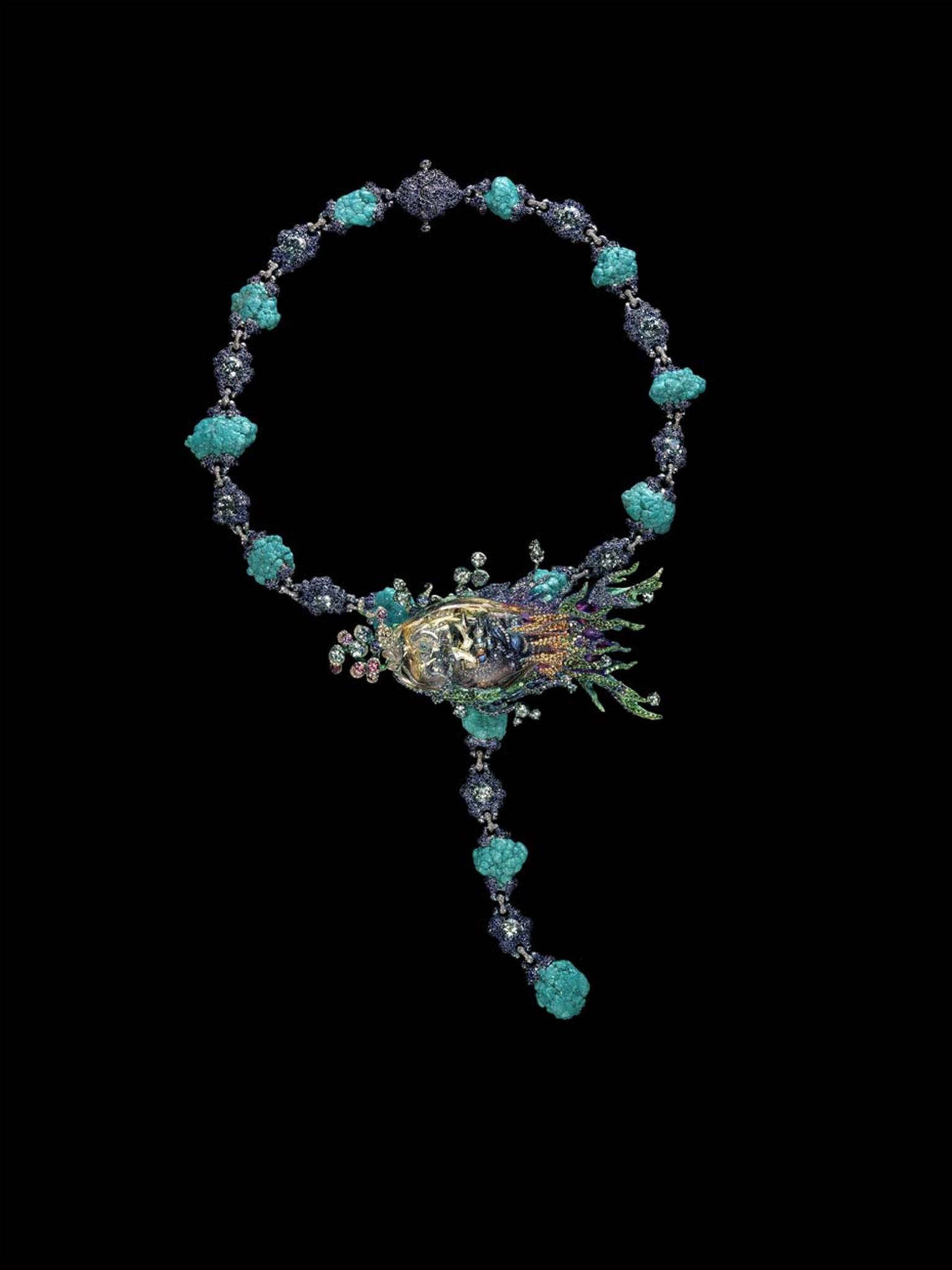 Wallace Chan combines the beauty of a yellow diamond with stunning coloured gemstones including aquamarine, turquoise and sapphire in this beautiful Ebb and Flow design where the fish takes centre stage.