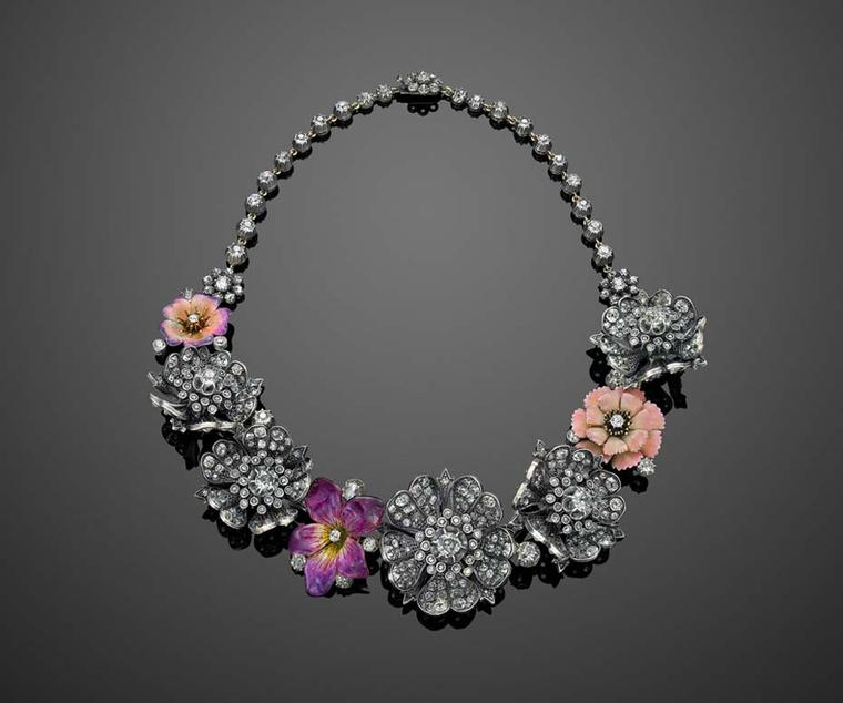 This stunning vintage necklace was worn by Nicole Kidman to the 2010 SAG Awards. Re-imagined by Fred Leighton, it features three 19th century pink and purple enamel flowers nestling between antique old-mine diamond flowers in their original, circa 1880s,