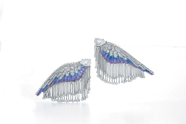 Actress Charlize Theron wore this magnificent pair of earrings, re-imagined by Fred Leighton, to the 2014 Met Gala, comprising a pair of antique-cut, pear-shape diamonds, set into antique diamond wings, with ombre enamelled feathers and a white gold and d